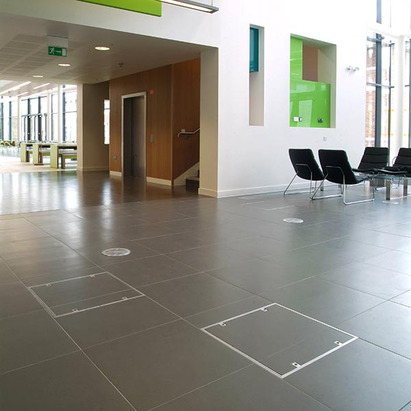 7500 series Howe Green aluminium floor access cover in a shopping centre